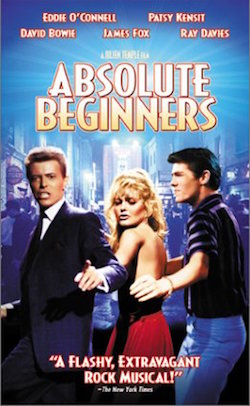 "A cover for a video tape of ""Absolute Beginners"", showing Bowie, Patsy Kensit and another male actor from the same film"
