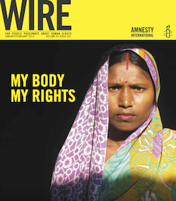 "A front cover of the Amnesty International magazine Wire. The word WIRE is printed in black capital letters at top left, underneath which it reads ""For people passionate about human rights. January/February 2014, Volume 44, issue 001"". The name Amnesty International and their logo of a candle with a piece of barbed wire round it appears on the right on the yellow strip. Below is a picture of a Hindu woman wearing a pink, yellow and turcquoise headscarf with a gold nose ring, a red dot above her nose and a red vertical line above that. Next to her, in yellow capital letters on a black background, it reads ""My body, my rights""."