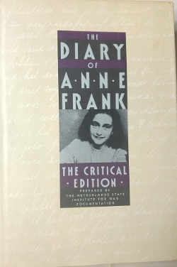 The cover of a book, reading 'The Diary of Anne Frank [picture of author] The Critical Edition, prepared by the Netherlands State Institution for War Documentation