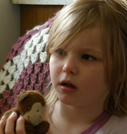 Picture of Ayn van Dyk, a 9-year-old white girl, with a brown and white cuddly animal toy
