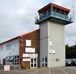 The main building and control tower of Blackbushe Airport