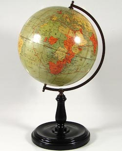 A globe from the time of the British empire, showing India large parts of Africa in pink, representing British possession