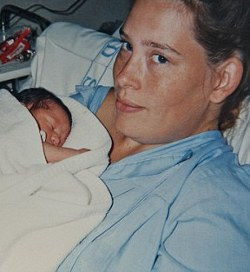 Picture of Claire Rayner with her newborn daughter, who did not receive a birth certificate