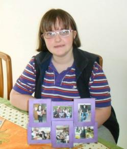 Picture of Claire Dyer, with some family photos in front of her