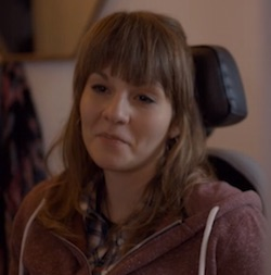 Picture of Anna, a young white woman in a wheelchair, played by Ruth Madeley