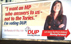 "A poster showing a young woman (a stock photo of a model) with the slogan 'I want an MP who answers to us, not to the Tories. I'm voting DUP""."