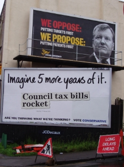 A Liberal Democrat election poster that reads 'We propose putting patients first; we oppose putting targets first' above a Tory poster that reads 'Imagine 5 more years of it' above a newspaper clipping with the headline 'Council tax bills skyrocket'