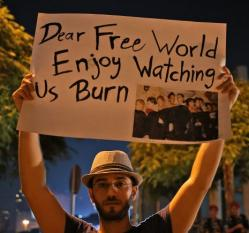 Picture of a man holding a banner saying 'Dear free world, enjoy watching us burn', with a picture of several dead bodies from the recent chemical attacks.