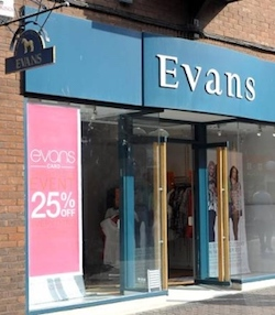 "A shop front with the name ""Evans"" in white over a dark green background; there are some posters showing off the clothing in the window, which is dominated by a large sign saying ""Evans card: 25% off"". The shop is set against red brickwork."