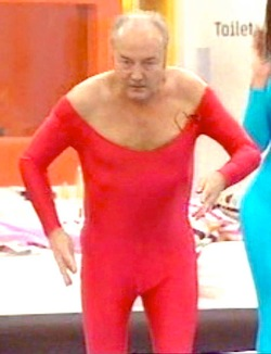 Picture of George Galloway in a red cat-suit with a substantial scoop neck, on Celebrity Big Brother