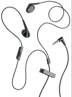 A hands-free kit consisting of a wire with a plug similar to a headphone jack, two earpieces, a microphone with a button, and a clip.