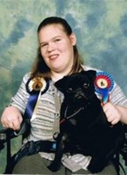 Picture of Heather Rutherford, a quadriplegic, with a pug she bred