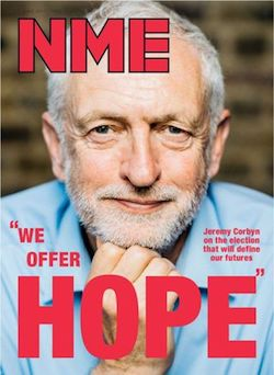 "A picture of Jeremy Corbyn, a white man with thinning white hair and a short white beard, with his hand up to his chin, wearing a light blue shirt and no tie. The date (June 2017) is barely visible at the top. The NME logo is in the top left and at the bottom is written ""We offer HOPE"": Jeremy Corbyn on the election that will define our futures."