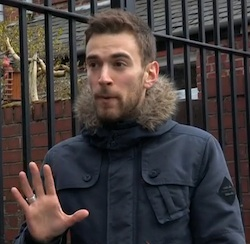Picture of Jonny Benjamin, a white man with stubble in a thick blue jacket with a furry collar