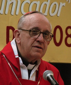 Picture of the current Pope, Francis I, then Archbishop Jorge Bergoglio of Buenos Aires, a white man with glasses and a red cap and jacket, also with a white 'dog collar' and a long silver necklace.