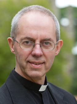Picture of Justin Welby, a thin-haired white man with a black overcoat with a white clerical collar (or 'dog collar')