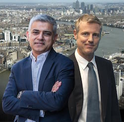 Picture of Sadiq Khan and Zac Goldsmith, presumably in a tall building, with a view of central London behind them