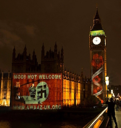 "The British Parliament before the Paris attacks, with an image of a swastika and the slogan ""Modi Not Welcome"" and the web address of Awaaz UK"
