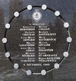 "A black marble plaque showing the names of the 14 victims of the 1989 Montreal massacre. There is a circle around them with 14 white metallic circles, with a logo of an insect at the top, the words ""In memoriam"" and the date (6 Dec 1989) at the bottom. For the names, click the image."