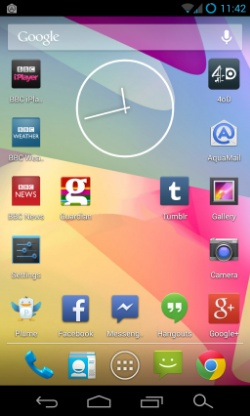 A screenshot of an Android phone, showing an analogue clock and various app icons