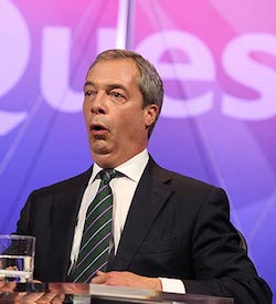 A picture of Nigel Farage, a white man in a black suit jacket with a white shirt and dark grey, pink and light purple striped tie, against the blue and pink backdrop of the BBC's weekly Question Time panel show.