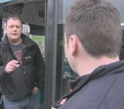 Image of internet troller who called himsef 'Nimrod Severn' who posts insulting messages on tribute sites, boarding a bus while being confronted by BBC reporter