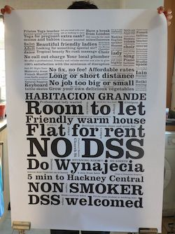 Someone holding up a poster featuring phrases commonly found in house/flat rental ads, including 'No DSS', 'DSS welcomed', 'Friendly warm house', 'Non-Smoker', 'No fix, no fee! Affordable rates' and many others in large and small lettering.