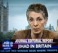 "Picture of Melanie Phillips, a white woman with short grey hair and glasses, on Fox News. Caption at the bottom says ""Journal Editorial Report: Jihad in Britain"""