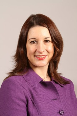 Picture of Rachel Reeves, a white woman with shoulder-length brown hair wearing a purple jacket