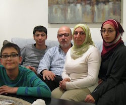Picture of Firas al-Rawi (centre) and his wife and children