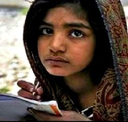 Picture of Rimsha Masih, a young girl with a head-scarf writing in a school book.