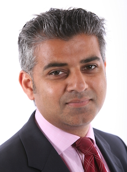 Picture of Sadiq Khan, a clean-shaven South Asian man with short, grey hair, wearing a pink shirt and red tie with a dark grey jacket.