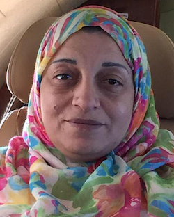 Picture of Sana bin Laden, a middle-aged Arab woman in a floral headscarf