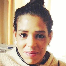 Image of Sarah Reed, a light-skinned Black woman wearing a cream coloured fleece top.