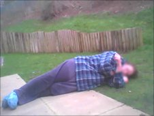 Picture of Simone, a care home resident, lying on the floor outside