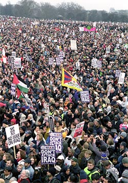 "Picture of an anti-war demonstration in 2003, showing a mass of people in Hyde Park, London, many holding banners saying ""Don't attack Iraq""."