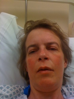 Picture of Sue Marsh, lying in a hospital bed