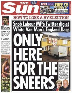 Front page of the Sun newspaper, showing a house covered in red and white English flags with a white Ford Transit van parked outside, with the headline \