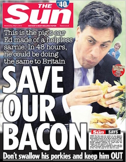 The front page of the Sun today (6th May), showing Ed Miliband eating a bacon sandwich, dropping some of it down his front, with the headline 'Save our bacon'.