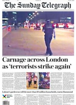 "A front page from the Sunday Telegraph with the headline ""Carnage across Londn as 'terrorists strike again'"". There is a large picture of a policeman walking across London Bridge at night, with stationary vehicles in the background."