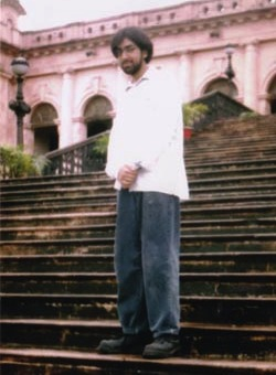 Picture of Talha Ahsan standing on some steps