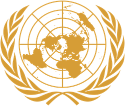 The emblem of the United Nations, showing a map of the world centred on the North Pole (i.e. a polar azimuth projection), with olive branches around it
