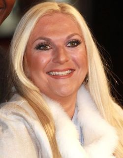 Picture of Vanessa Feltz, a white woman with long blonde hair wearing a thick white coat of some sort