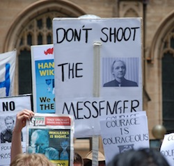 "Pro-Wikileaks demonstration outside Sydney Town Hall, 2010; posters read ""don't shoot the messenger"" and ""courage is courageous"""