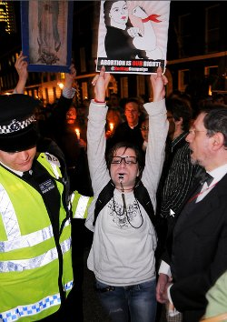 Picture of woman holding up abortion rights banner in London