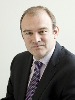 Picture of Edward Davey, a white man in a dark grey suit with a blue tie