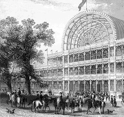 Drawing of the Crystal Palace, a glass and iron building with a flag flying above it, with a group of people, some on horseback, in front of it, with a tree to the left.
