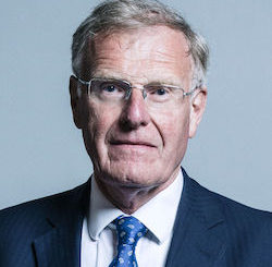 Picture of Christopher Chope, a white man in late middle age wearing glasses with thin metal rims, a white shirt, a blue tie and a dark grey jacket.