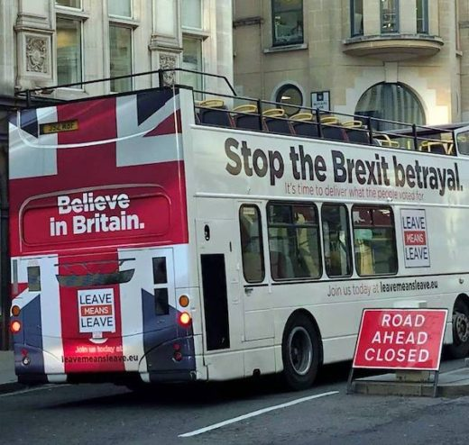 "An open-top double-deck bus, painted white with the Union flag painted across the back with the words ""Believe in Britain: Leave Means Leave"". On the right-hand side the text reads ""Stop the Brexit betrayal""."