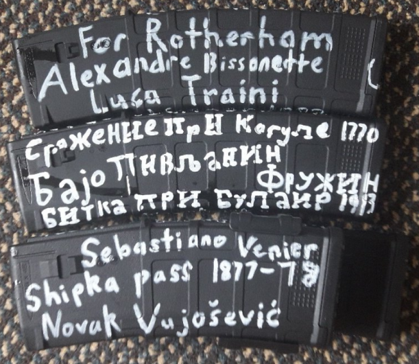 "A picture of three of the automatic rifle magazines used in the Christchurch massacre. They have English and Serbian writing on them, including ""For Rotherham"" and the names of mass shooters Alexandre Bissonette and Luca Traini."